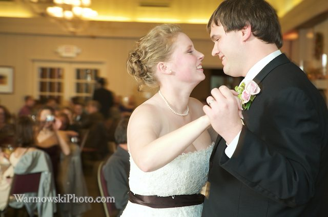 Jenni & Michael's friends were hooting and hollering after their first dance song. Copyright Warmowski Photography