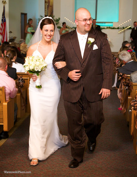 Julie and Phil walk down the aisle after their ceremony at First Christian Church in South Jacksonville.