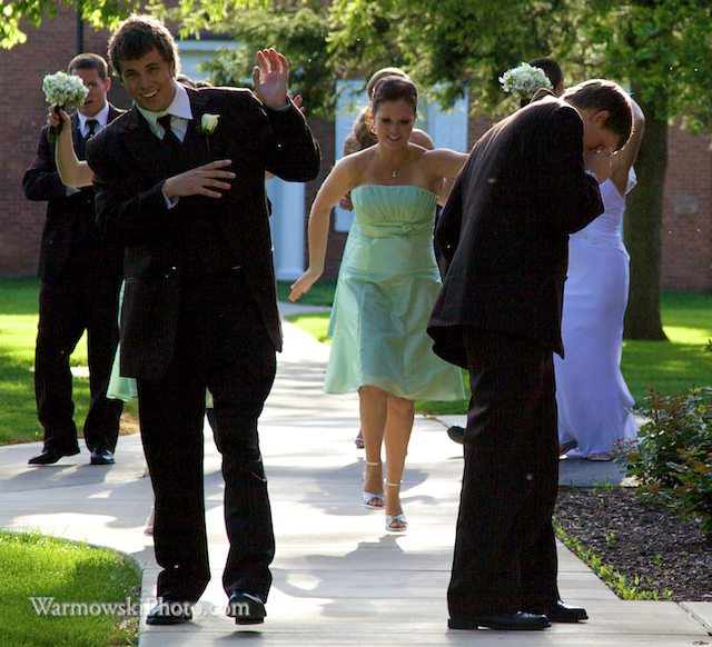 As soon as Julie and Phil's wedding party got out of the limo to take photos at Illinois College, they were swarmed by buffalo gnats.