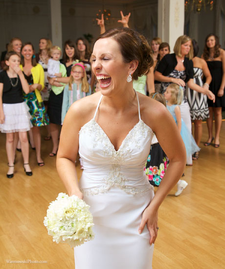Julie prepares to toss her bouquet during her reception at Hamilton's 110 North East in Jacksonville.