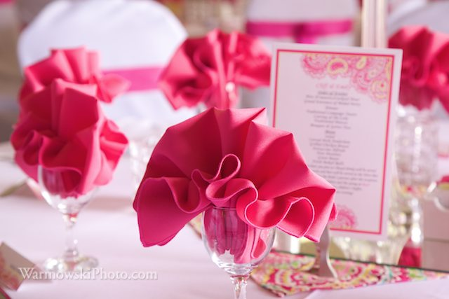Emily & Cliff chose hot pink and yellow for their colors. Here you can see the menu cards and napkins set on the table ready for guest at McClelland Dining Hall, MacMurray College, Jacksonville, IL.