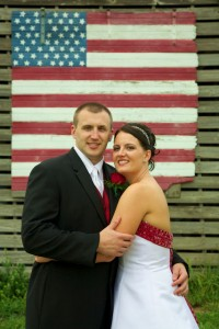American flag on barn, backdrop for portrait