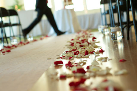 Rose petals along aisle.