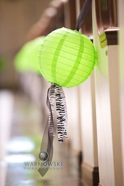Instead of flowers, the pew decorations were lime green Chinese lanterns with zebra-striped ribbon hanging from them. Copyright 2010 Warmowski Photography