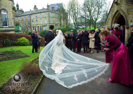 Veil swoops as bride walks out of church