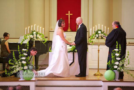 Wade Fanning adjusts his sister's train during her marriage to Francis Nelson Saturday, June 12, 2010, in Jacksonville, Illinois.