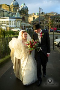 Bride & Groom walk near old opera house in Buxton, UK