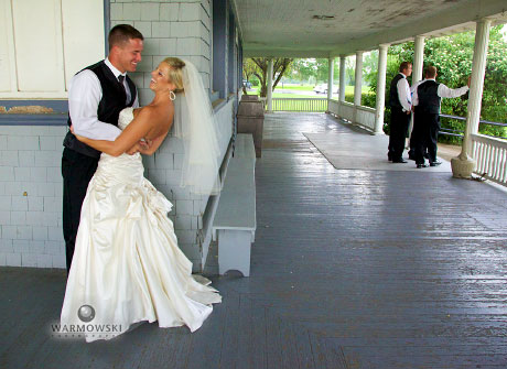 Groom dips bride while waiting out storm, Warmowski Photography wedding images