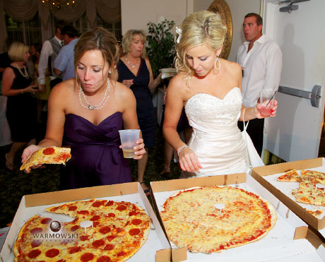 Bride selects pizza at reception, wedding images by Warmowski Photography