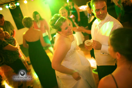 Bride & groom dance during reception, lit dance floor. Wedding images by WarmowskiPhotography.com