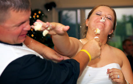 Bride gets nose full of frosting, cake cutting, wedding reception in Virginia Illinois by Warmowski Photography