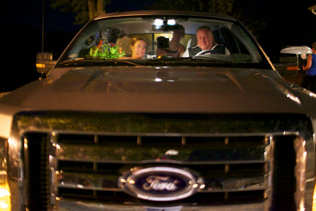 Night time view of passengers in truck, after wedding in Virginia Illinois by Warmowksi photography