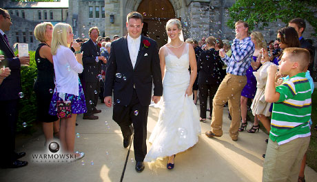 Bride & groom showered with bubbles after service, Warmowski Photography.