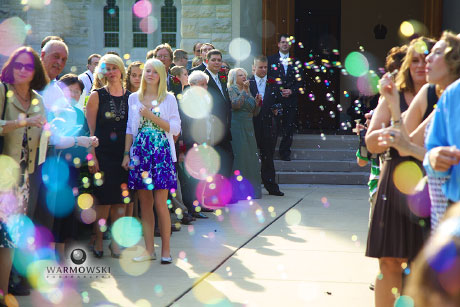 Bubbles catch the light after wedding, photo by Warmowski Photography