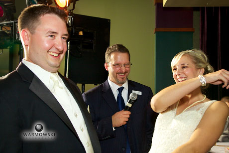 Bride & groom laugh with DJ, photo by Steve Warmowski