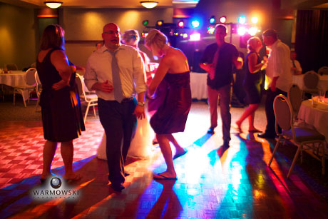 Dance floor lit with lights from DJ, image by Warmowski Photography