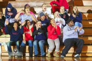 MacMurray College students clap and cheer during a basketball game, Warmowski Photography.