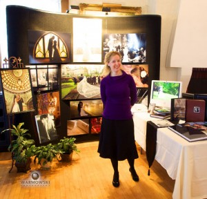 Tiffany Hermon Warmowski at trade show in front of booth