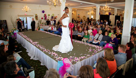 Model shows off wedding gown during bridal fashion show, Warmowski Photography