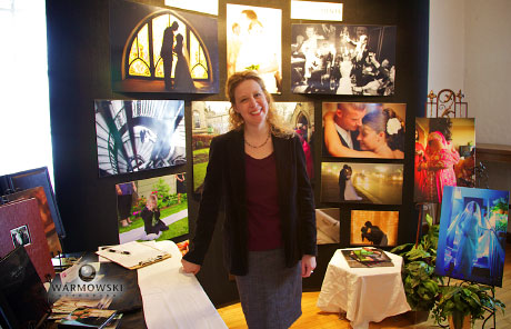 Tiffany with our photos and sample books at the Rushville bridal show.