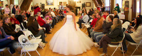 Modeling wedding gown at bridal expo in Rushville, Illinois