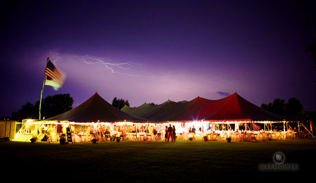Lightning flashes over tent at a wedding reception in Carrollton, Illinois