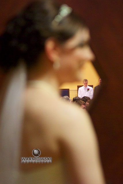 Monica waits while Luther stands at the front of the church during the processional.