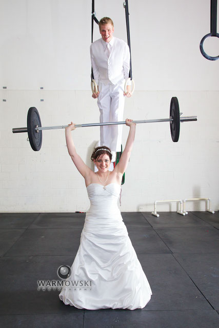 I loved the murmurs of disbelief from the bridal party as Monica's bar had the weights put on it.