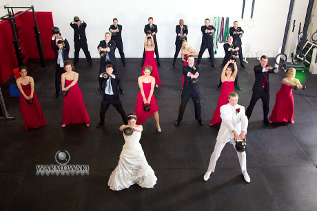 Between the wedding and reception, Monica and Luther wanted to stop by their CrossFit gym and have a photo taken of the bridal party doing a kettlebell swing. There was a quick lesson on form by the owner, Jason, before we started. Safety first!.