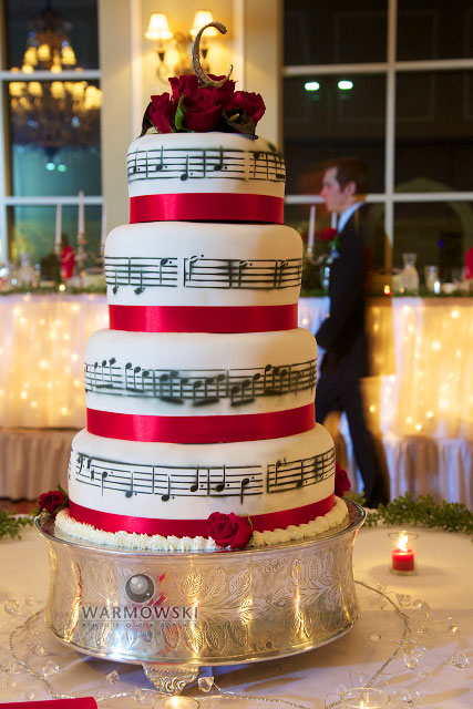 "The processional song that Monica's bridesmaids walked in to was arranged by Monica's brother, Anthony. It's a combination of ""Jesu, Joy of Man's Desiring"" and ""Canon in D."" The notes on the cake is the score of that song."