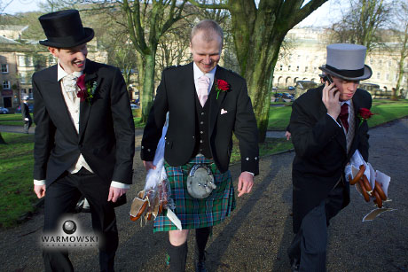 Groom walks through English park with groomsman in Kilt _ WarmowskiPhotography.com