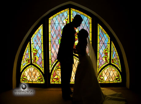 silhouette in front of stained glass window, www.warmowskiphoto.com