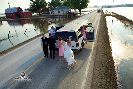 Bridal party behind limo on flooded road, www.warmowskiphoto.com