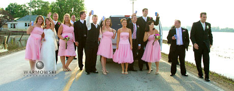 wedding party behind limo on flooded road, www.warmowskiphoto.com