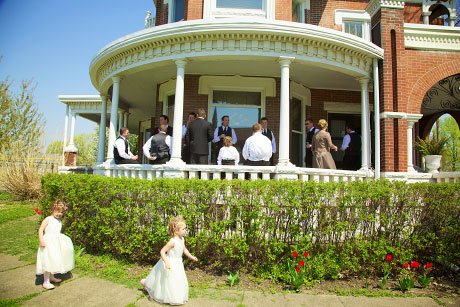 porch of historic home with flower girls running on sidewalk, warmowskiphotography.com