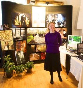 Tiffany Warmowski in front of trade show booth