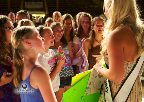Queen Calla Kaufmann greets fans from Stevens School of Dance.