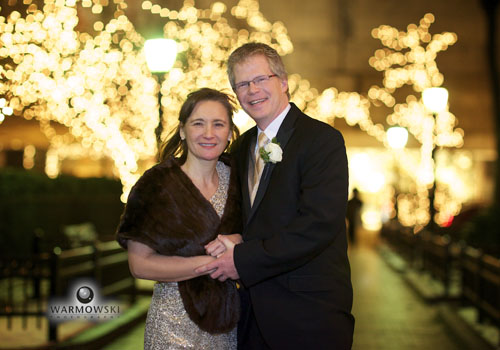 Portrait bride & groom (gold sequin dress) out in the cold across from the Ritz-Carlton Chicago. http://www.warmowskiphoto.com