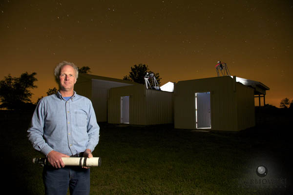 Robert E. Holmes with his first telescope and his latest telescopes he uses to track objects for NASA at Astronomical Research Observatory.