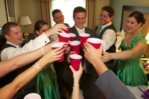 Wedding party toast in the bridal suite, before the reception at Bloomington Holiday Inn.