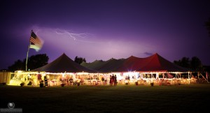 Summer wedding in Carrollton Illinois of Hannah & Joe with lightning from a passing storm. Image on Signature Rentals.