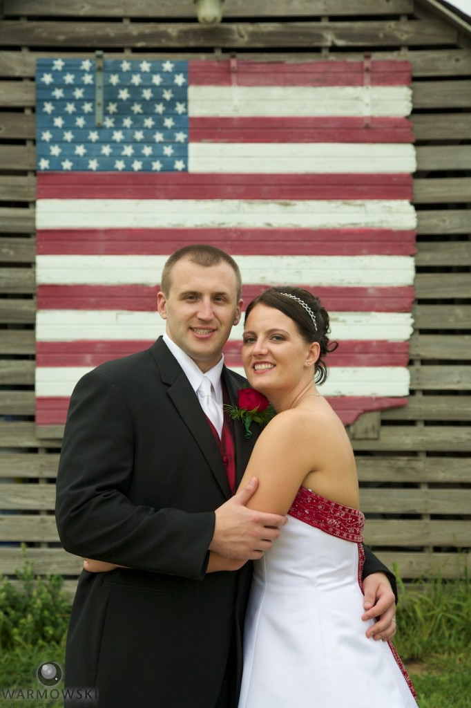 Kassie & Matt with an iconic folk ark flag at Buena Vista Farms.