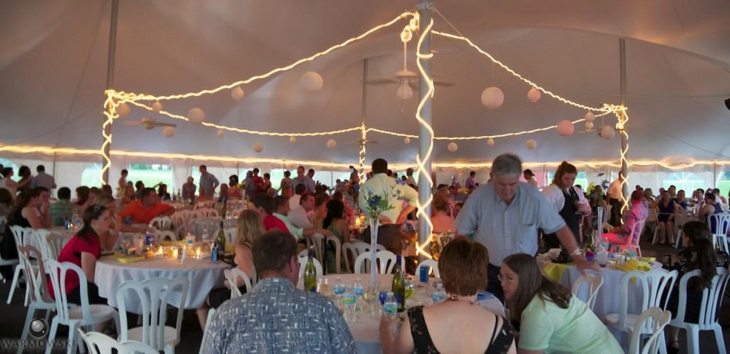 Wedding tent lit up at dusk for Ashlee & Justin's wedding.