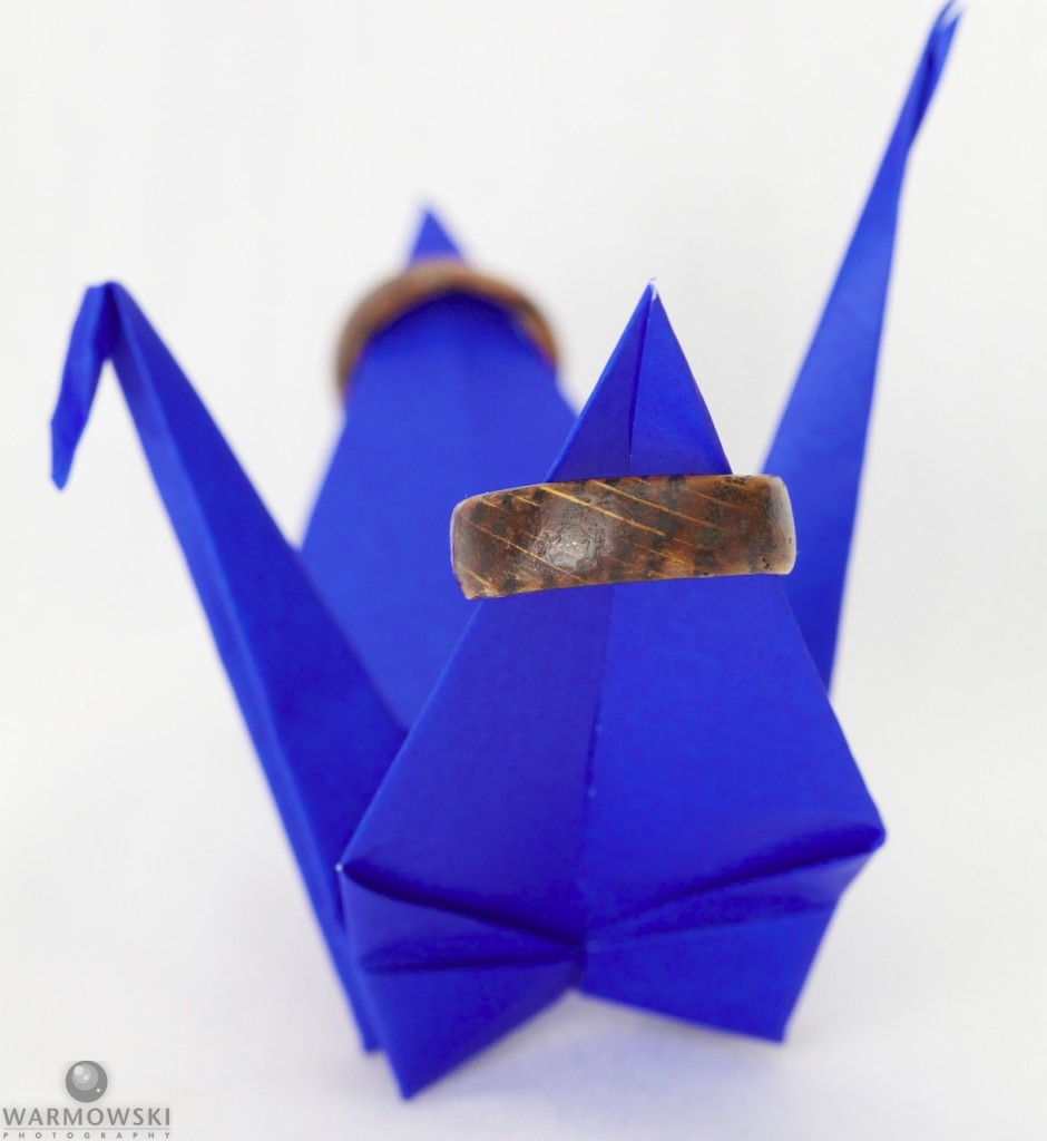 Shiori carved her and Brett's wedding rings on lucky crane origami.
