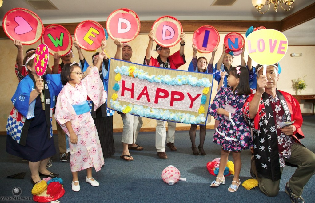Shiori's family provides entertainment for wedding reception guests.