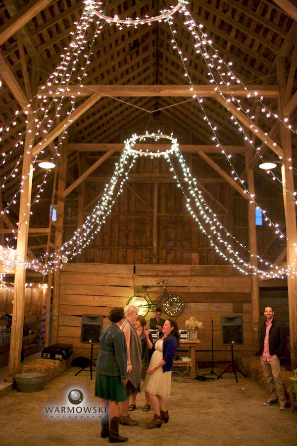 Dance floor inside barn. Katie's dad cleaned out the barn, put in hard gravel floor.