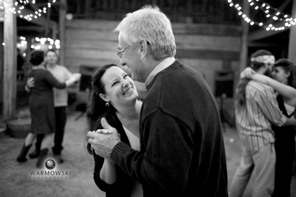 Katie dances with her father.