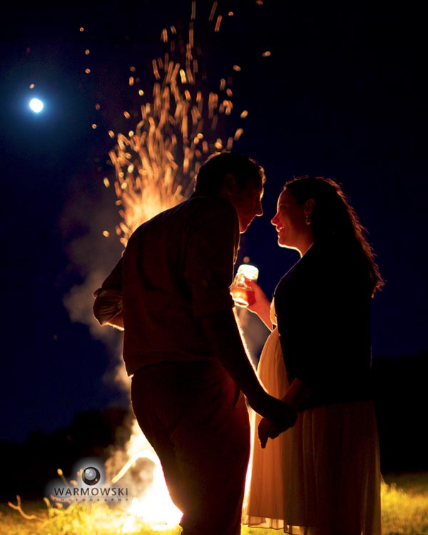 Bride & groom in front of bonfire