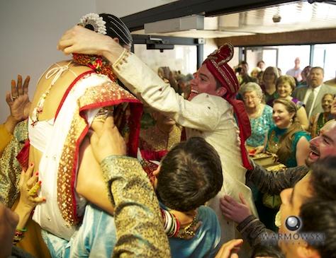 Bride's family lifts Rushita, making it harder for Benjamin to put on necklace - Rushita & Benjamin (by Warmowski Photography)