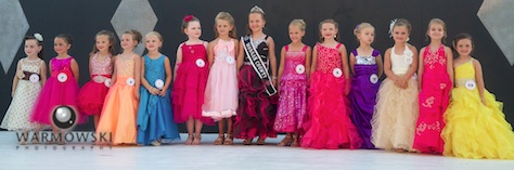 Princess contestants in dresses.